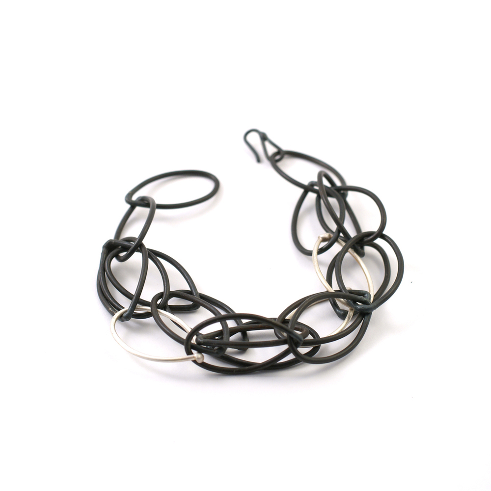 black and silver multi chain bracelet by megan auman