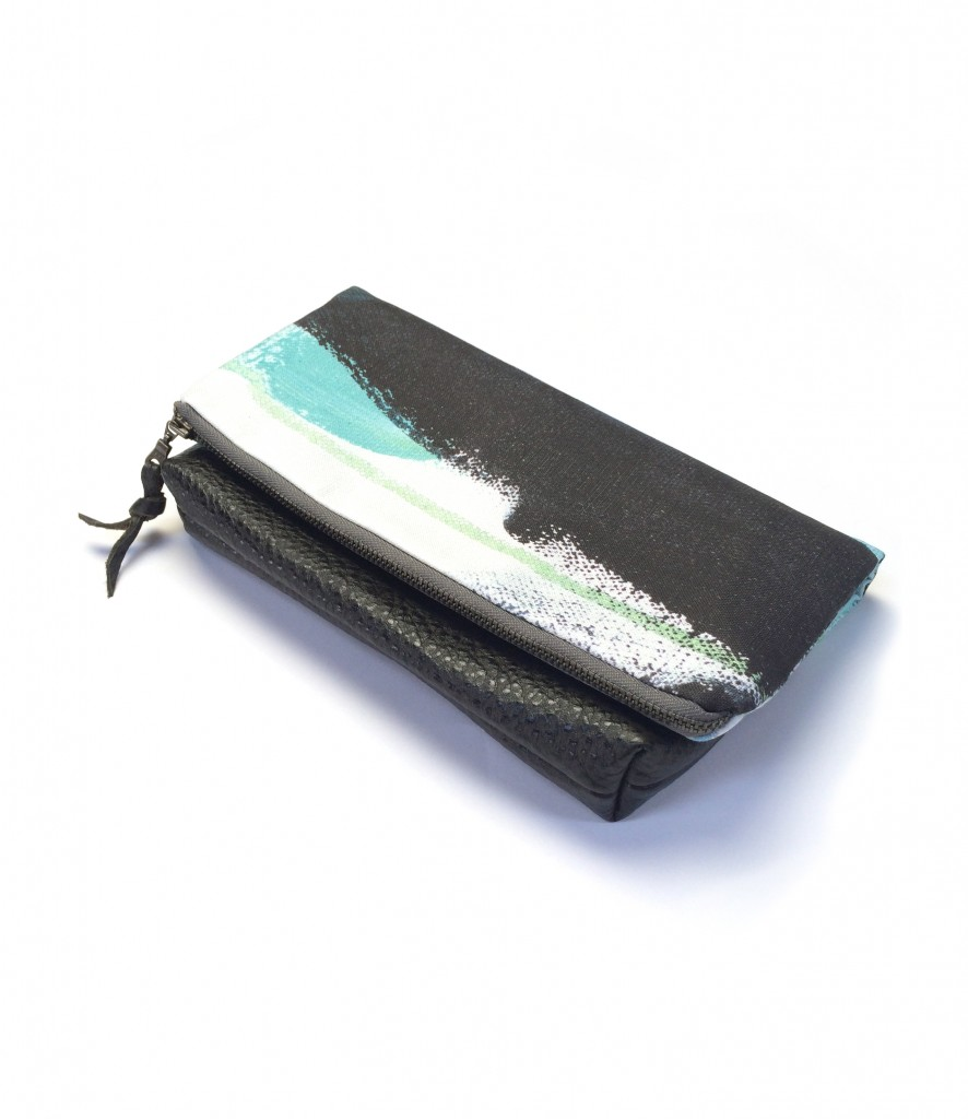 wings foldover clutch purse in teal, black, and white