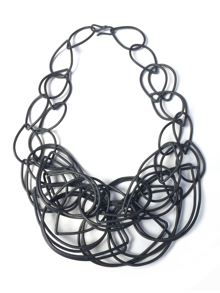 gritty meets glam - steel statement necklace by megan auman