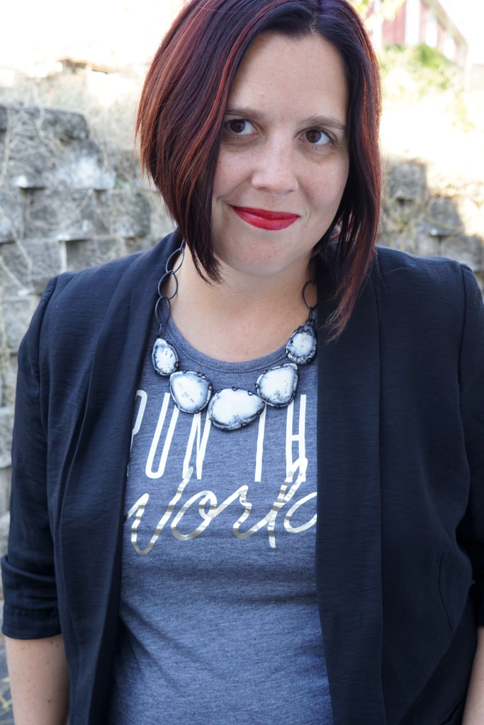 statement necklace and run the world t-shirt with blazer