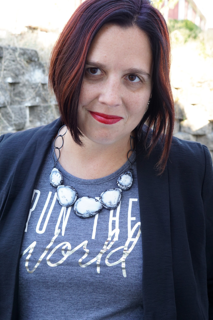 statement necklace and printed t-shirt with blazer