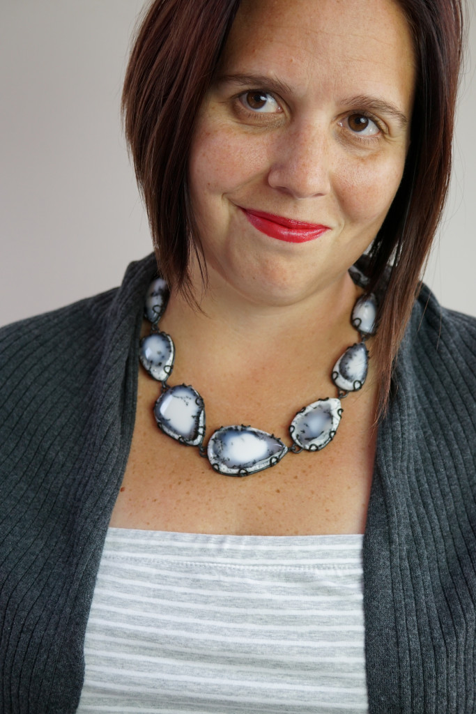 elegant casual style: black and white gemstone necklace with strapless dress and cardigan