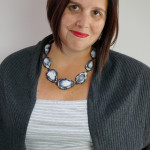 Contra Composition Necklace No. 29 with a grey and white dress and cardigan