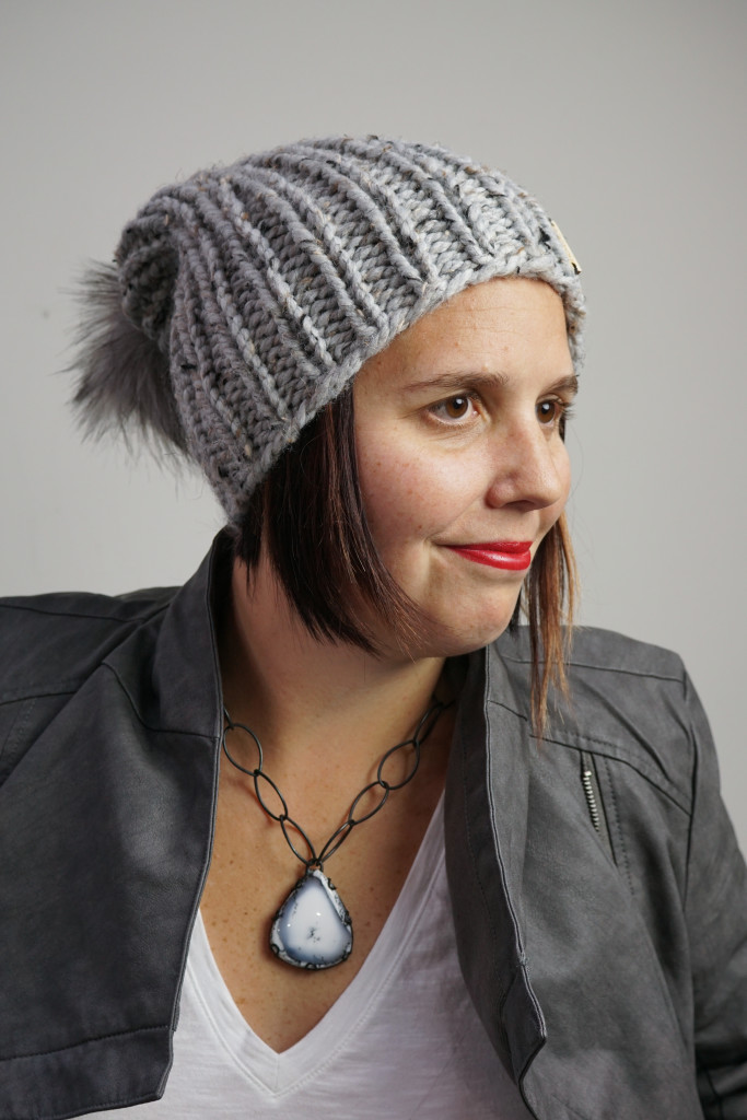 edgy and sweet winter style: knit hat, faux leather jacket, chunky amulet necklace