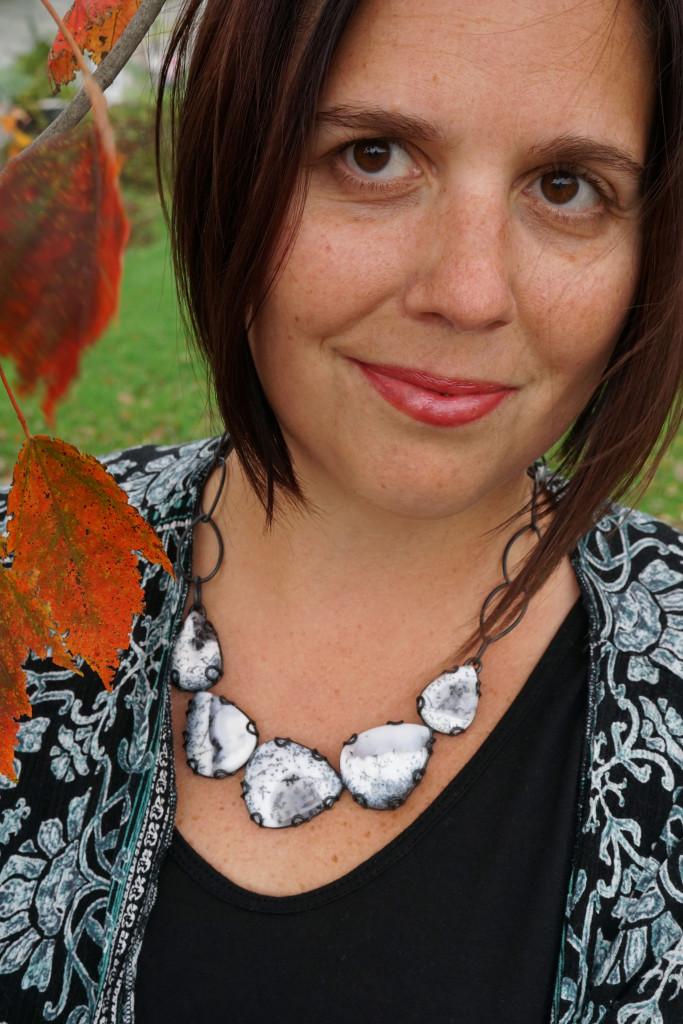 fall style portrait with one of a kind black and white statement necklace and kimono top