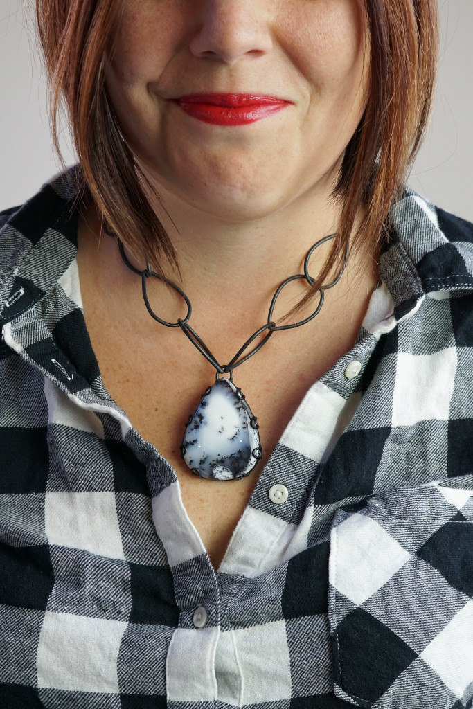 what necklace to wear with a plaid flannel shirt: chunky black and white chain link gemstone necklace