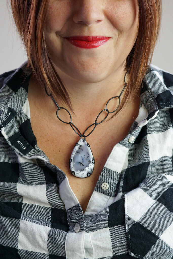 what necklace to wear with flannel button down shirt: chunky amulet gemstone necklace