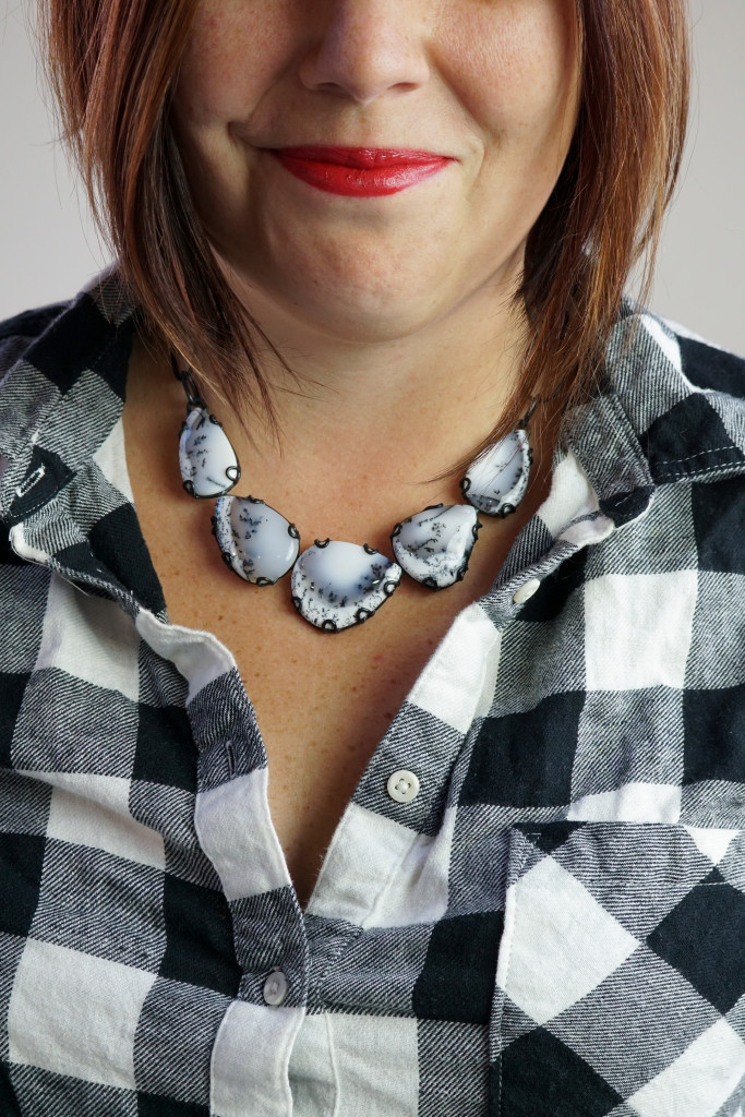 black and white gemstone statement necklace with black and white flannel plaid button down shirt