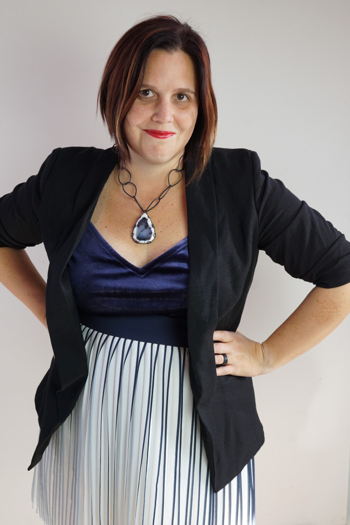 office holiday party outfit: navy and black with one of a kind gemstone necklace