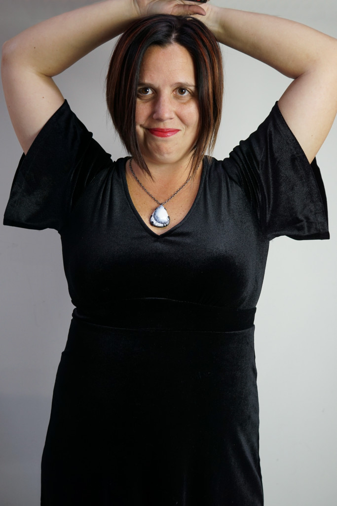 holiday party outfit: velvet little black dress and gemstone pendant necklace