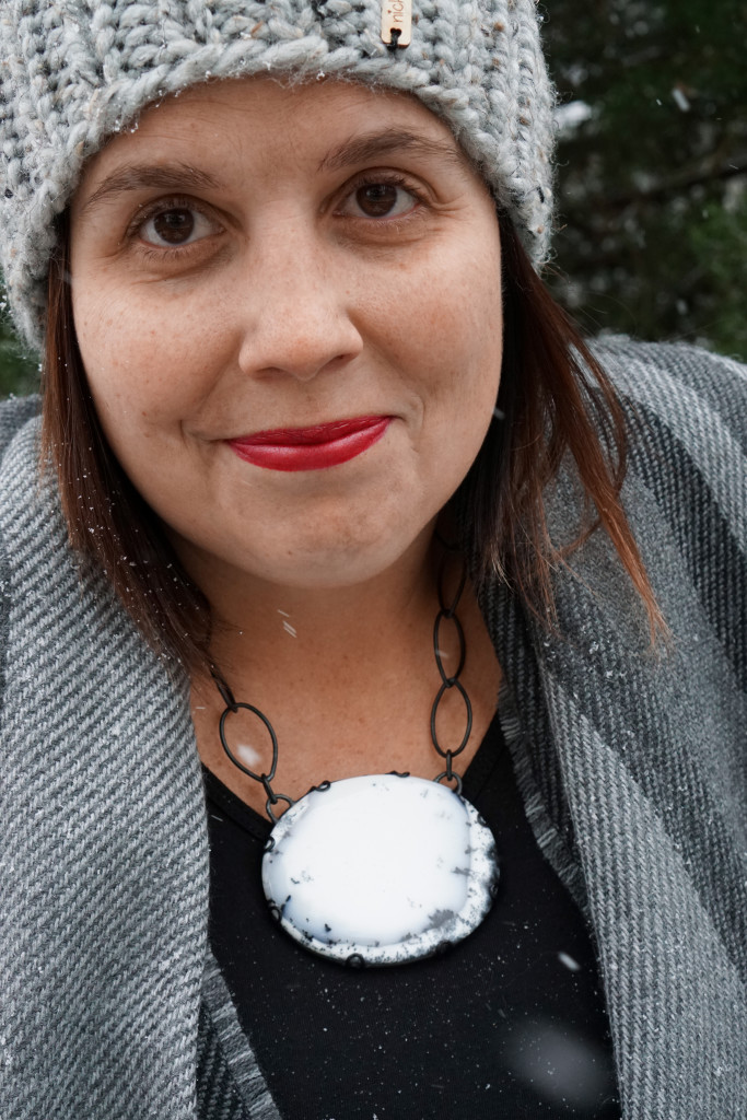 winter style: snowy winter portrait with black and white statement necklace
