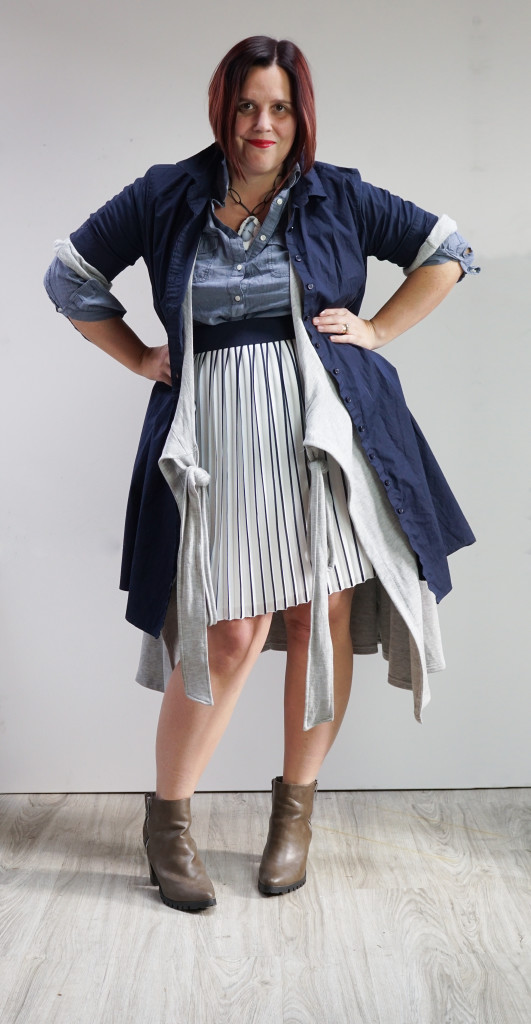 one dress thirty ways challenge, creative layering: shirt dress and wrap dress over pleated skirt and chambray shirt with bold gemstone necklace