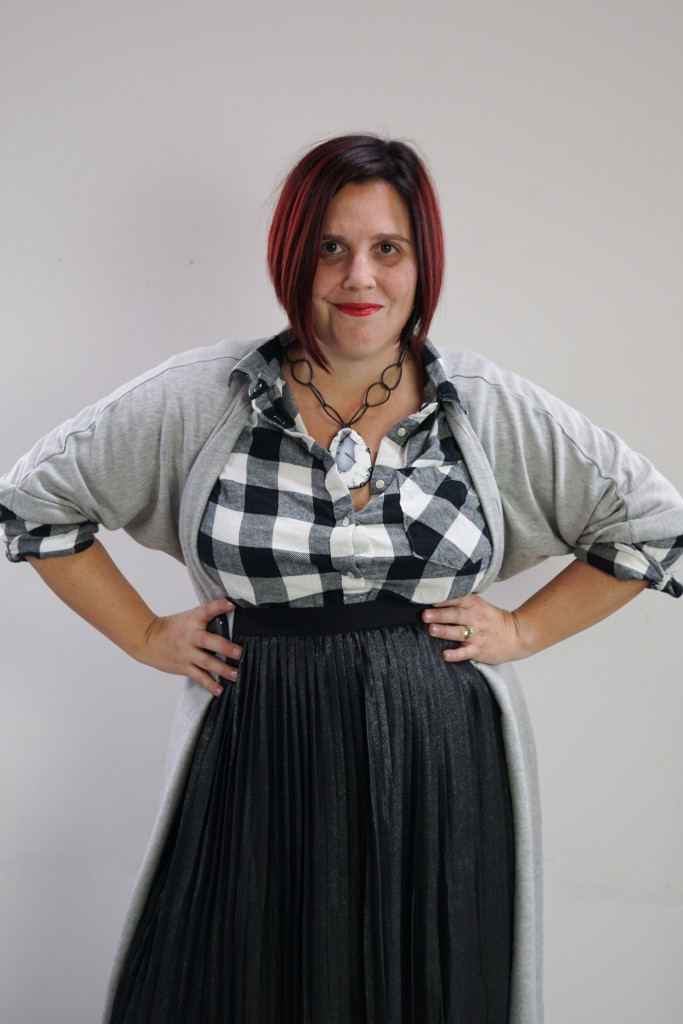 one dress, thirty ways creative style outfit inspiration: grey wrap dress as duster over black and white plaid shirt and black pleated skirt with giant gemstone statement necklace