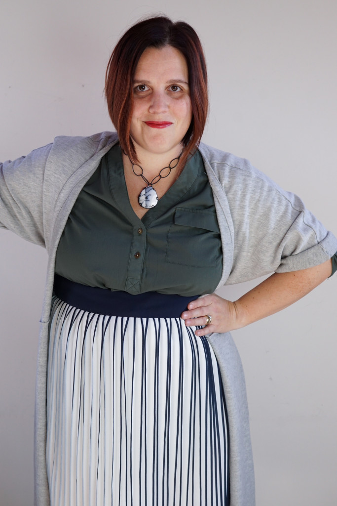 one dress, thirty ways: creative outfit ideas: wrap dress over shirt dress and pleated skirt with chunky gemstone necklace