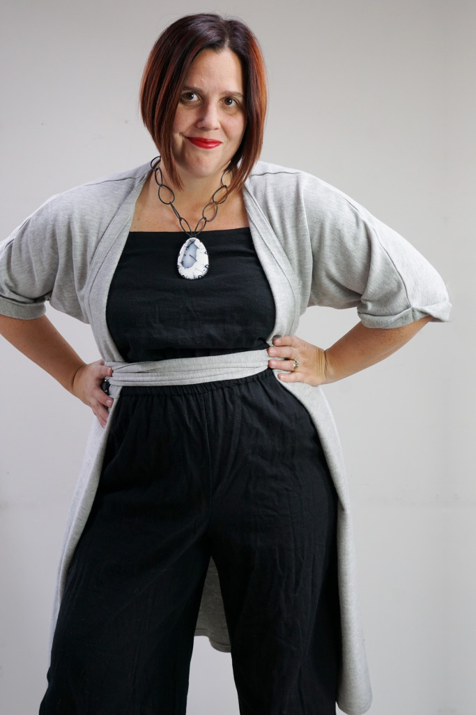 one dress, thirty ways outfit inspiration: grey wrap dress over black jumpsuit with chunky gemstone statement necklace