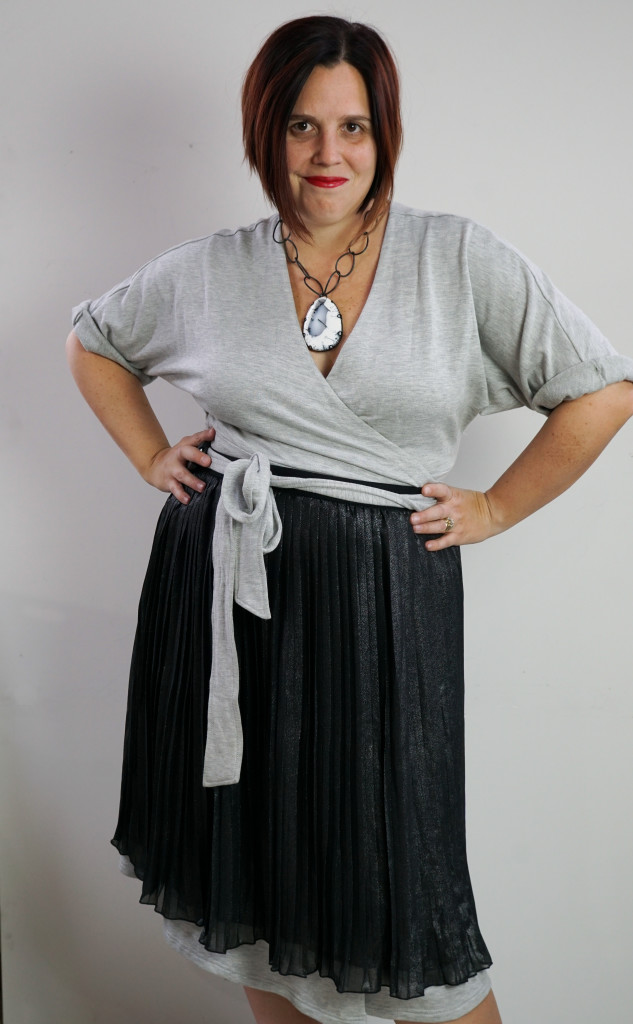 one dress, thirty ways style inspiration: inspired by late 50s, early 60s movie style: grey wrap dress, black pleated skirt, and chunky gemstone statement necklace (for a touch of attitude)