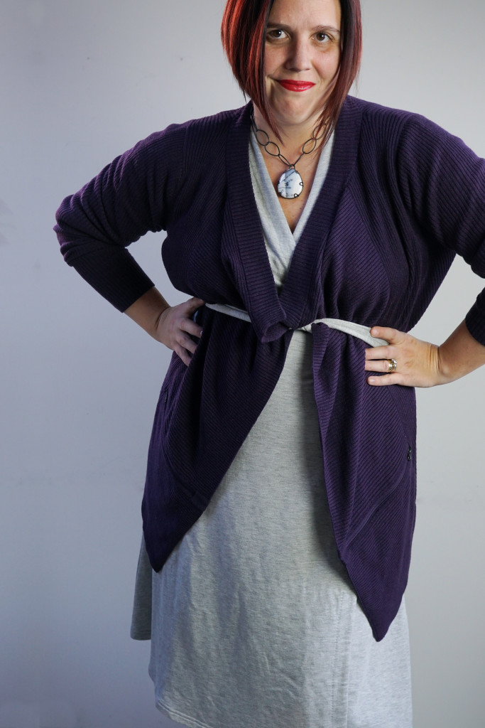 one dress, thirty ways outfit inspiration: grey wrap dress with purple cardigan and chunky gemstone necklace