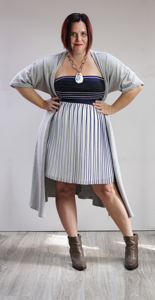 one dress thirty ways outfit inspiration: grey wrap dress over pleated skirt and strapless dress with chunky amulet necklace