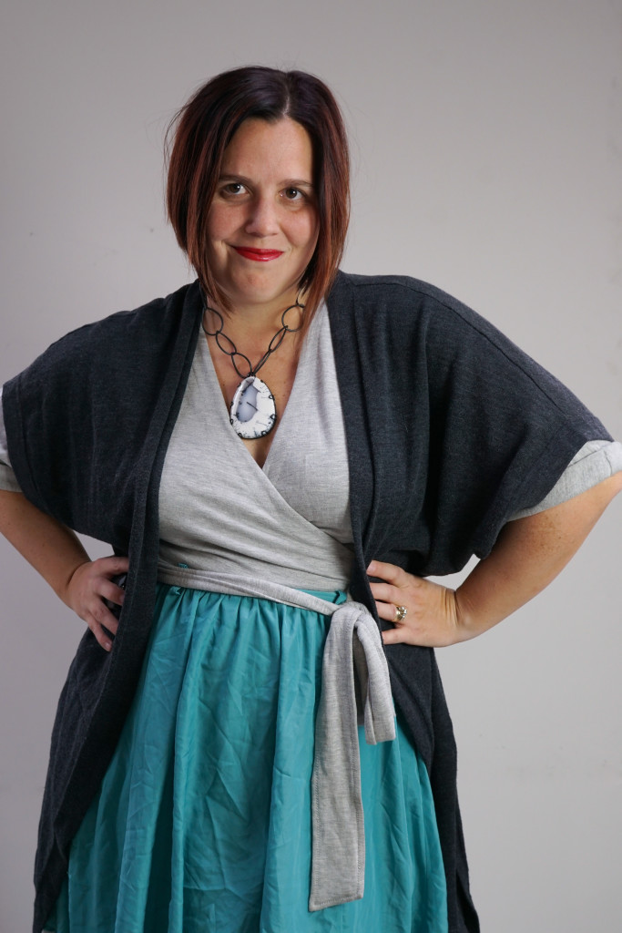 one dress, thirty ways style inspiration: playing with layers with a grey wrap dress, aqua skirt, charcoal cardigan, and chunky gemstone statement necklace