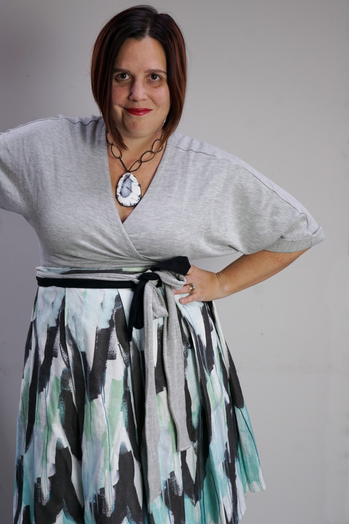 one dress, thirty ways - creative style outfit inspiration: a styling trick to wear a patterned pleated wrap skirt over a wrap dress