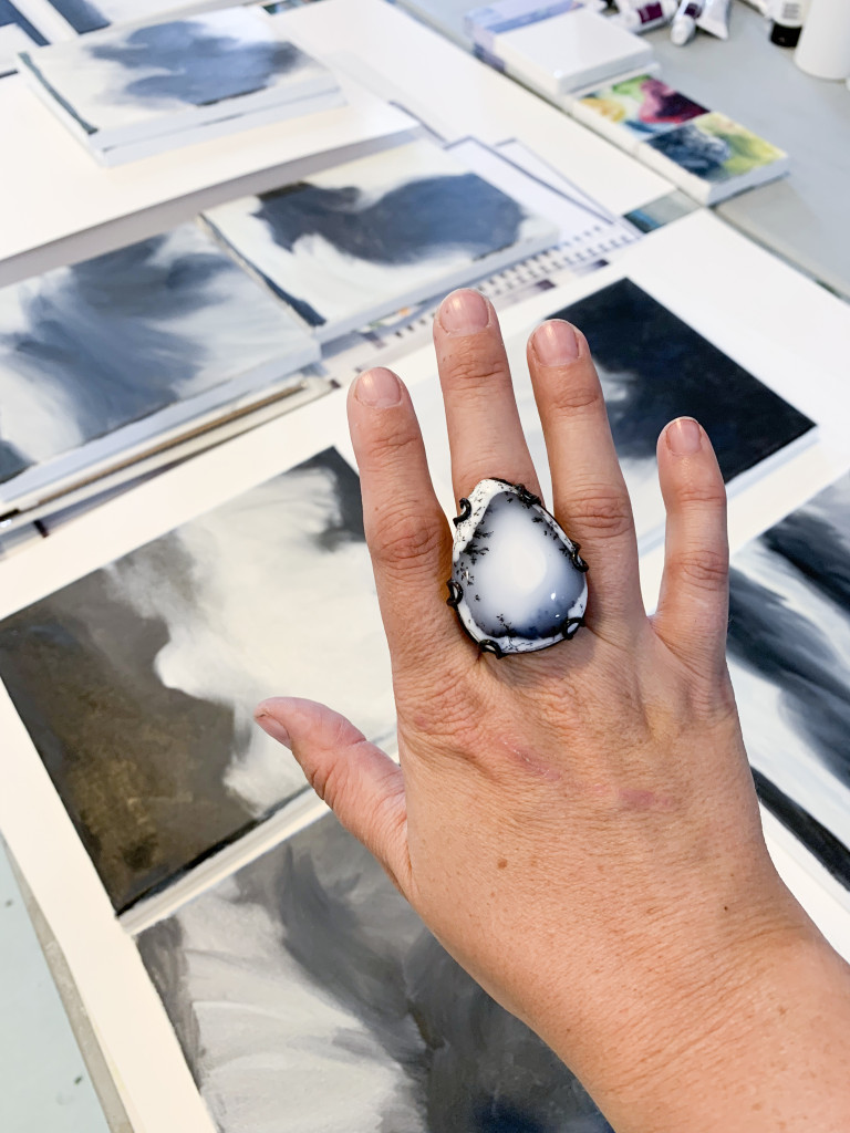 black and white gemstone statement ring and black and white paintings