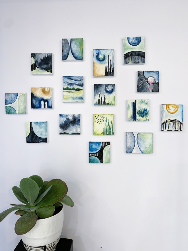 gallery wall with plant and tiny oil paintings