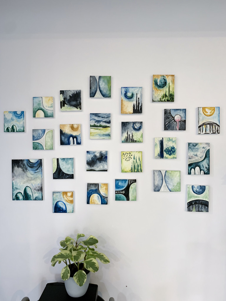 gallery wall with tiny abstract paintings