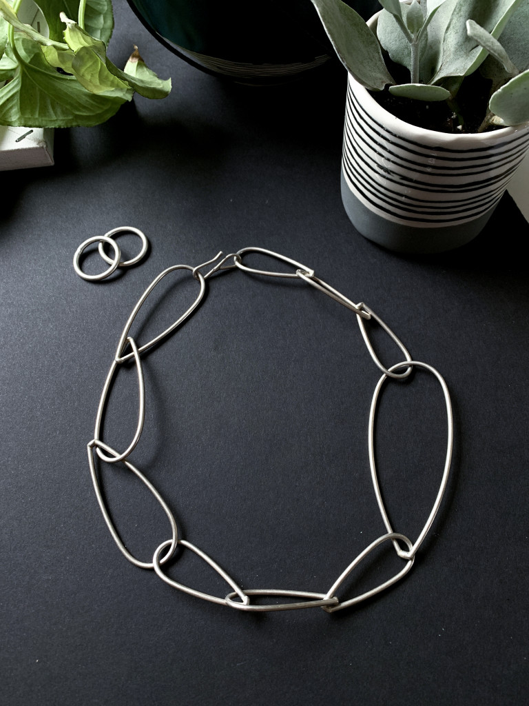 bold modern silver statement necklace and stacking rings