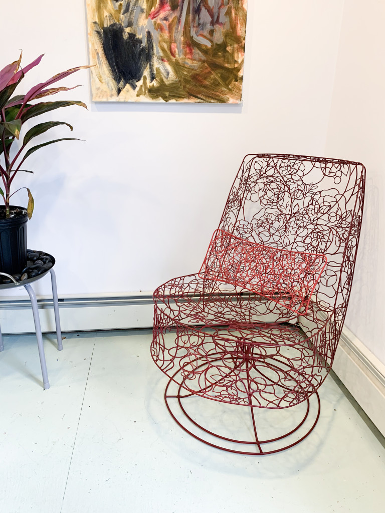 welded wire chair with painting and plant