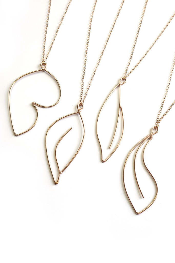bronze necklaces inspired by minimal floral tattoos, Mattise,  and Georgia O'Keeffe