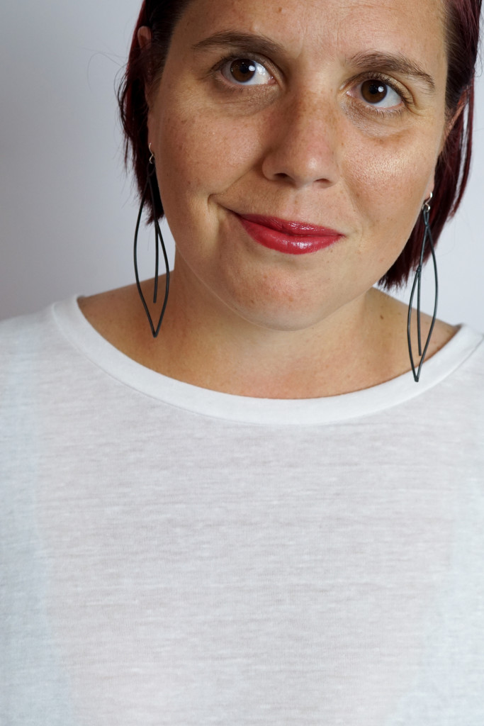 black statement earrings with white t-shirt and red lipstick