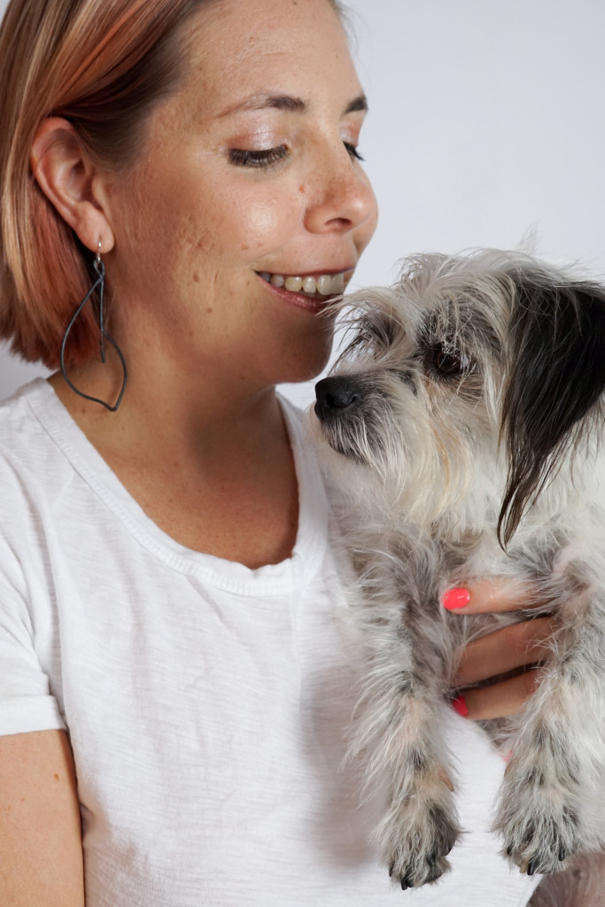 black statement earrings with white t-shirt and black and white dog